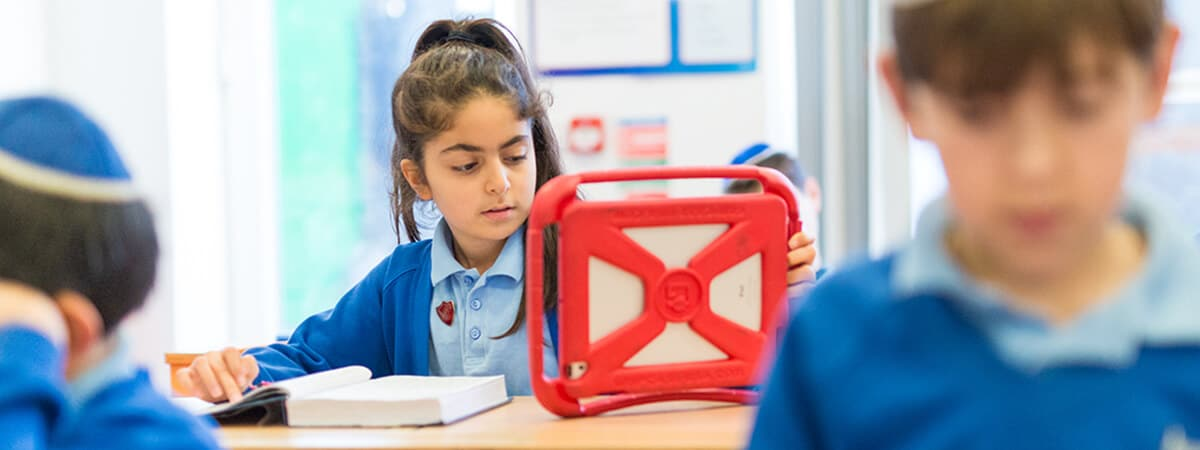 A Sacks Morasha pupil using a tablet computer during a lesson