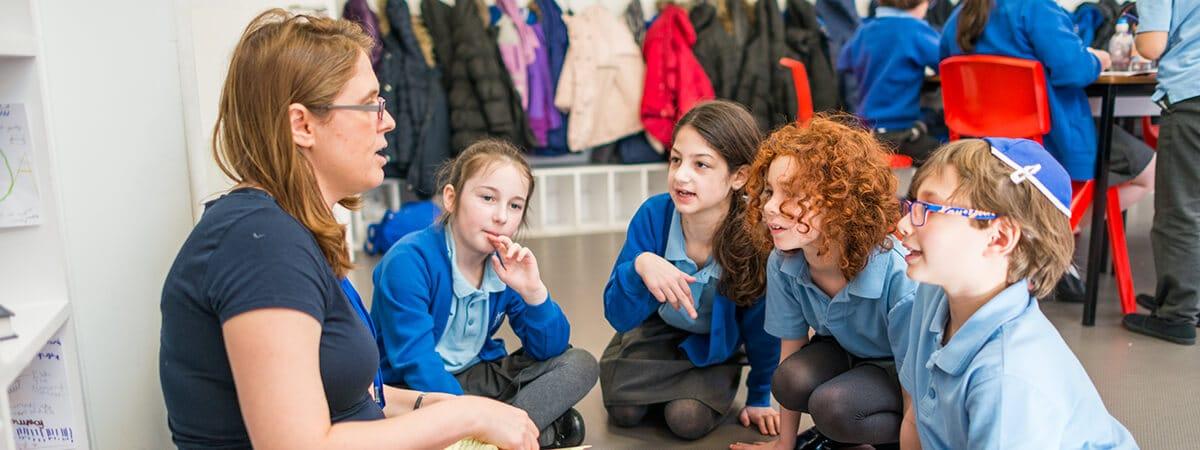 Sacks Morasha teacher with a small group of pupils