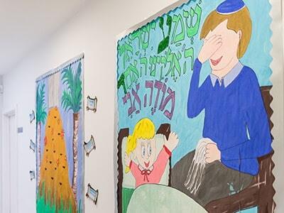 Art by pupils adorning the corridors at Sacks Morasha Jewish Primary School