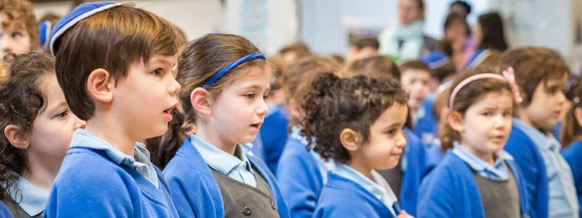 Sacks Morasha pupils taking part in assembly