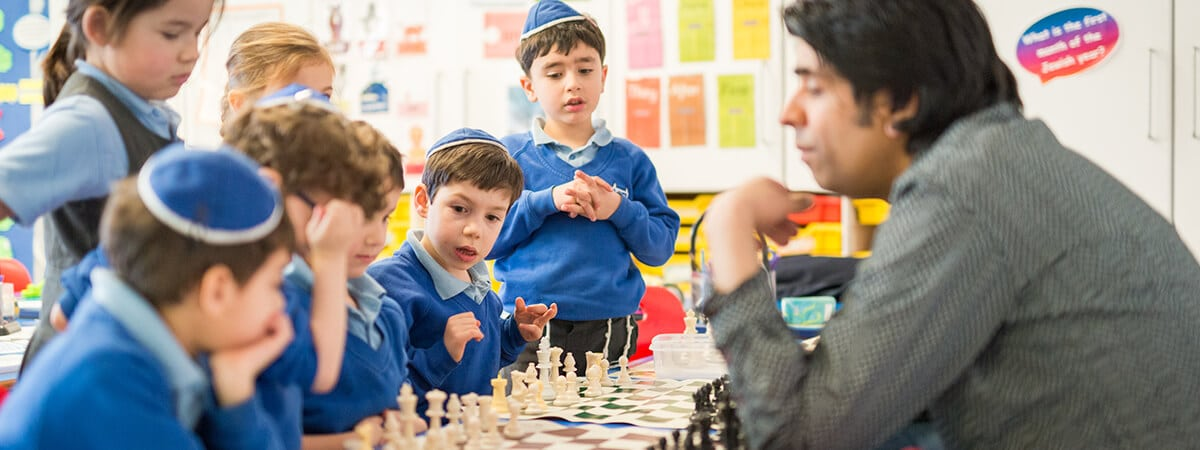 Sacks Morasha pupils learning chess in an after school club