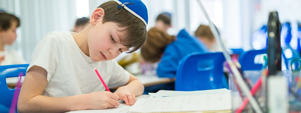 A pupil concentrating hard on his schoolwork