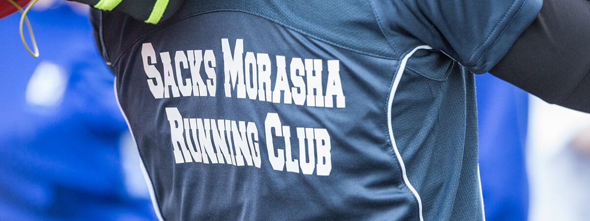 The back of a pupil's sports top, bearing the name Sacks Morasha Running Club