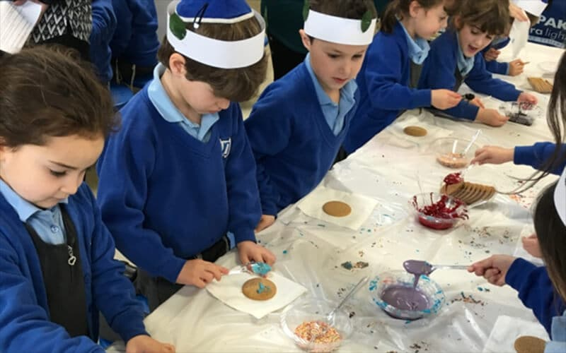 Year 5 Sacks Morasha pupils taking part in the Chanukah Activity Morning