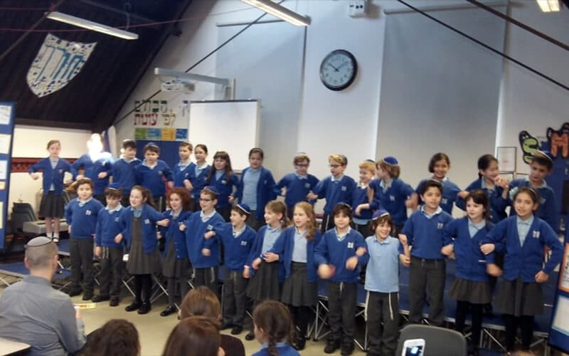 Sacks Morasha Year 4 pupils taking part in the Chanukah Morning