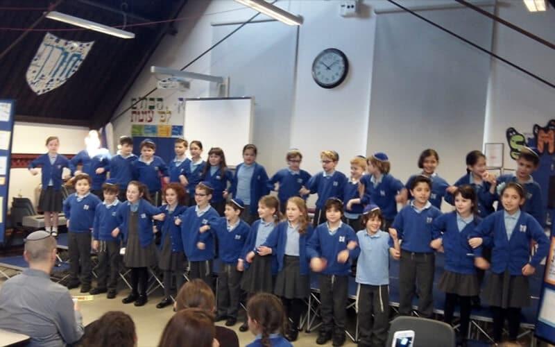 Sacks Morasha Year 4 pupils taking part in the Chanukah Morning