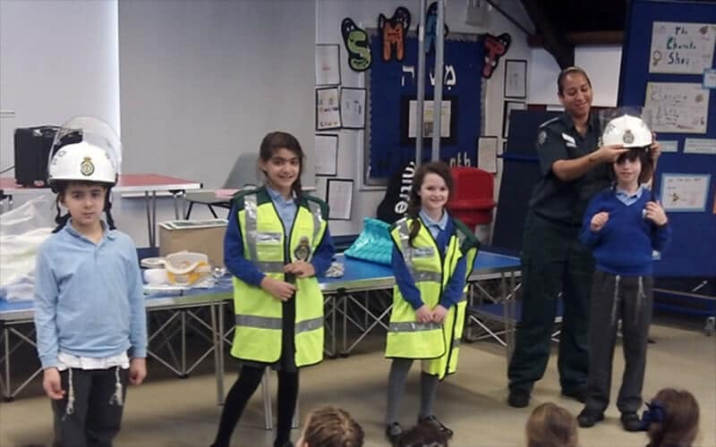 Sacks Morasha pupils enjoying the visit from a London Ambulance Service paramedic