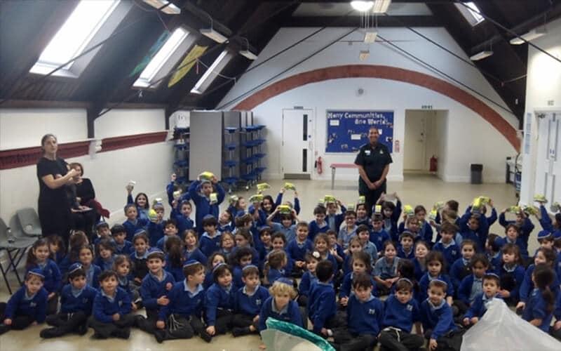 Sacks Morasha pupils enjoying the visit from a London Ambulance Service paramedic