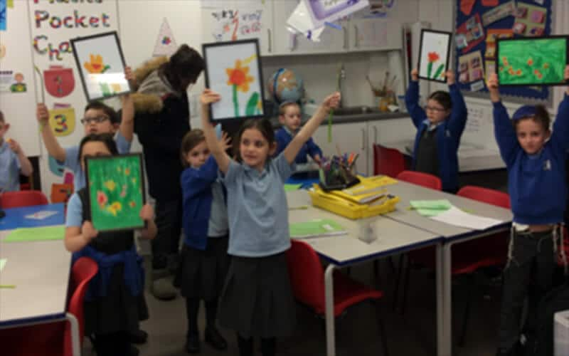 Year 2 Sacks Morasha pupils raising money for Marie Curie with their art sale