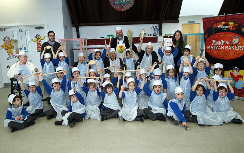 Sacks Morasha pupils enjoying Matzah baking