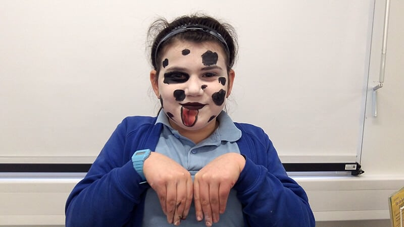 A Sacks Morasha pupil trying out face paint