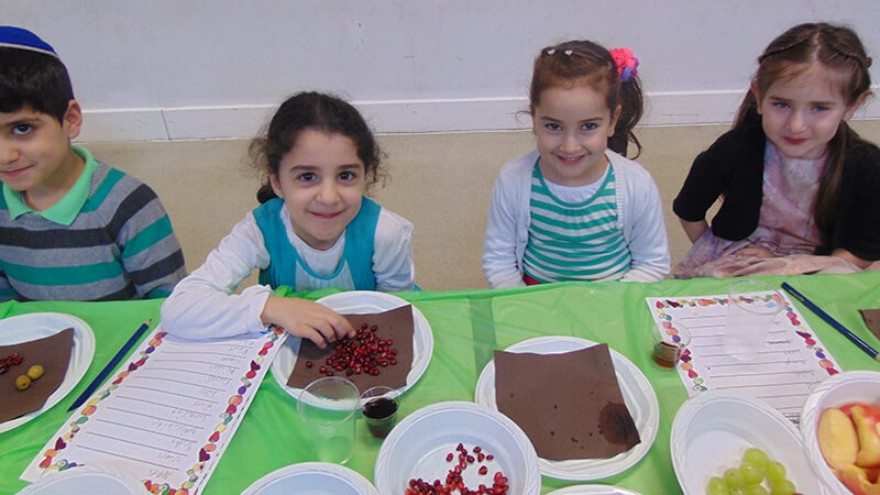 Sacks Morasha pupils taking part in Tu B'shvat Seder
