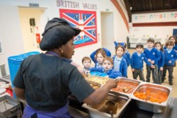 Pupils being served lunch at Sacks Morasha Jewish Primary School